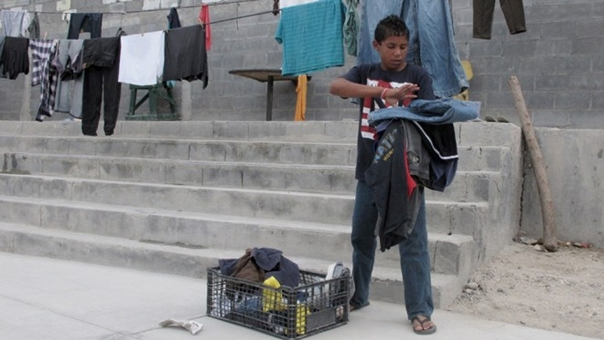 Brian Duran, 14, of Honduras at the Senda de Vida shelter in Reynosa, Mexico, June 3, 2014.