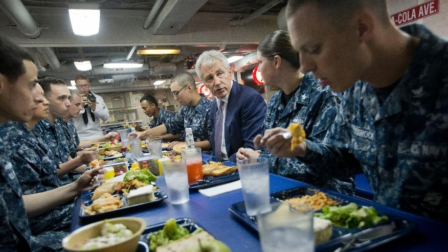 U.S. Defense Secretary Chuck Hagel center, has lunch with sailors aboard the USS Vella Gulf during his visit to Constanta, Romania, Thursday, June 5, 2014. (AP Photo/Pablo Martinez Monsivais, Pool)