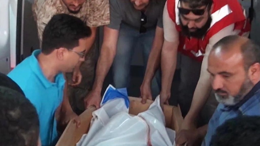 This image made from AP video shot on Wednesday, June 4, 2014 shows the body of a staff member of the International Committee of the Red Cross (ICRC), who was killed by armed men near the city of Sirte, which is around 550 kilometers (340 miles) east of Tripoli, Libya. ICRC Director-General Yves Daccord said in a statement on the organization's website Thursday, June 5, 2014 that Michael Greub, a 42-year-old Swiss national, was killed when the men attacked his car after he left a meeting.(AP Photo via AP video)