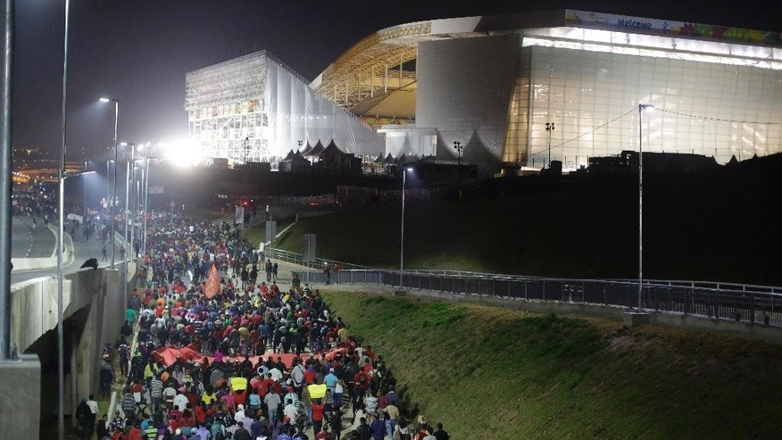 Members of the Homeless Workers Movement march in front of Arena Corinthians stadium during a protest demanding better public services and against the money spent on the World Cup preparations in Sao Paulo, Brazil, Wednesday, June 4, 2014. (AP Photo/Nelson Antoine)