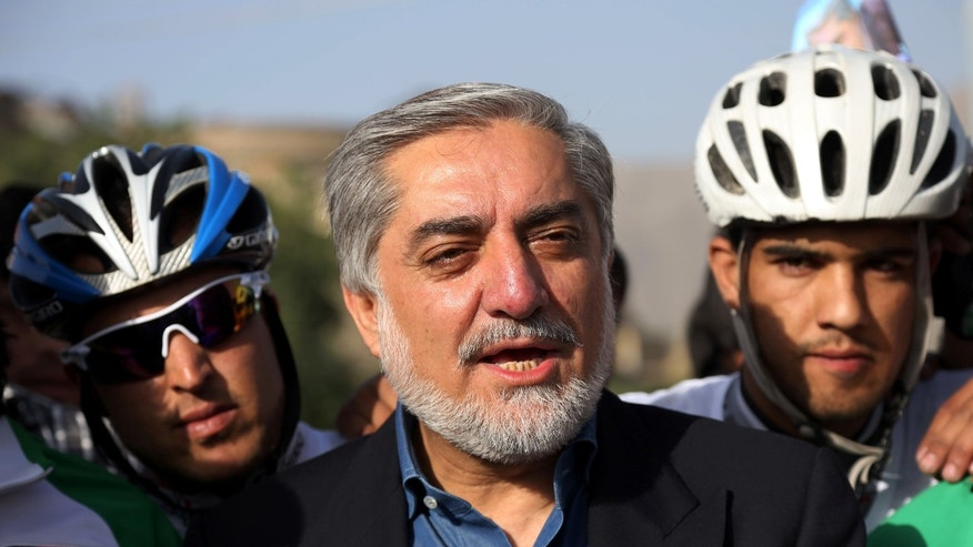 June 6, 2014 - Afghan presidential candidate Abdullah Abdullah talks with supporters in Kabul, Afghanistan. 2 blasts struck a convoy carrying Abdullah, killing several civilians but leaving the candidate himself unharmed.