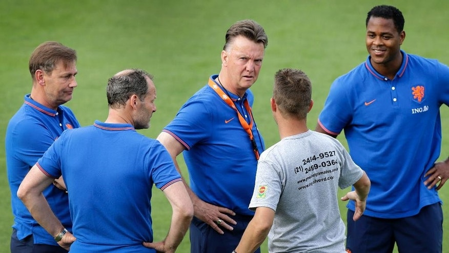 Louis van Gaal, coach of the Netherlands soccer team, center, speaks to his coaching staff during a training session in Rio de Janeiro, Brazil, Friday, June 6, 2014. The Netherlands plays in group B of the 2014 soccer World Cup. (AP Photo/Wong Maye-E)