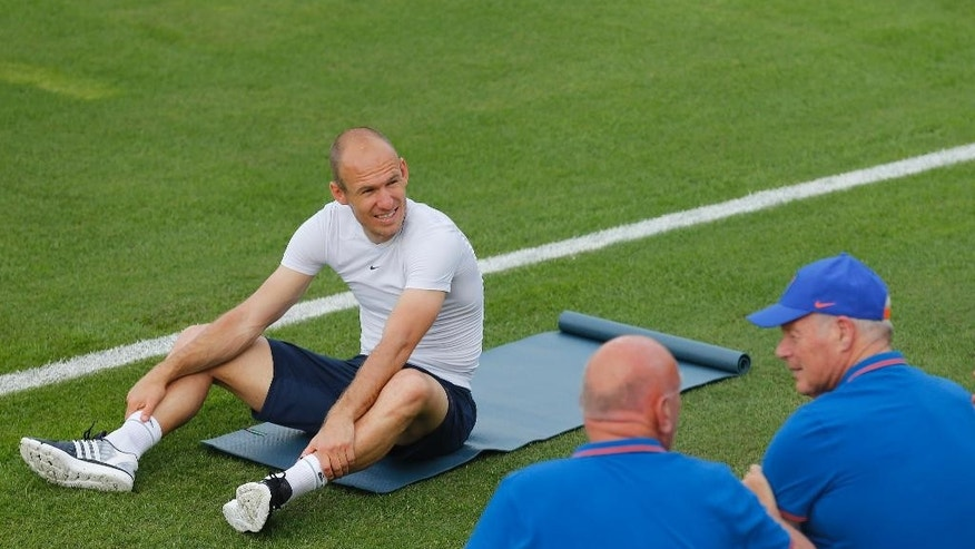 Arjen Robben of the Netherlands soccer team stretches during a training session in Rio de Janeiro, Brazil, Friday, June 6, 2014. The Netherlands plays in group B of the 2014 soccer World Cup. (AP Photo/Wong Maye-E)