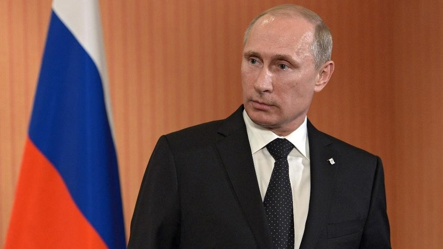 Russian President Vladimir Putin speaks to the media at Benouville castle, Friday, June 6, 2014, where he arrived for the 70th anniversary of the D-Day landings. World leaders and veterans gathered by the beaches of Normandy on Friday to mark the 70th anniversary of World War Two's D-Day landings. (AP Photo/RIA Novosti, Alexei Nikolsky, Presidential Press Service)