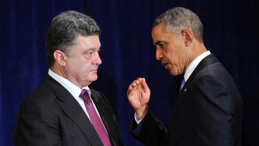 U.S. President Barack Obama, right, meets with Ukraine president-elect Petro Poroshenko in Warsaw, Poland, Wednesday, June 4, 2014. President Barack Obama says Ukraine can be a vibrant, thriving democracy if the United States and the international community stand behind it. (AP Photo/ Mykola Lazarenko, Pool)