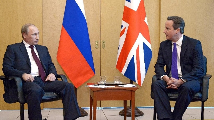"In this Thursday June 5, 2014 photo, British Prime Minister David Cameron, right, meets with Russian President Vladimir Putin at Charles De Gaulle Airport in Paris, as they are in France ahead of the 70th anniversary of D-Day commemorations. Cameron said he gave Russian president Vladimir Putin a ""very clear and firm set of messages"" during face-to-face talks in Paris about the crisis in Ukraine and told him the status quo was ""not acceptable"". The hastily arranged meeting happened after the leaders of the G7 warned that Russia could face damaging economic sanction unless it changed course. (AP Photo/RIA Novosti, Alexei Nikolsky, Presidential Press Service)"