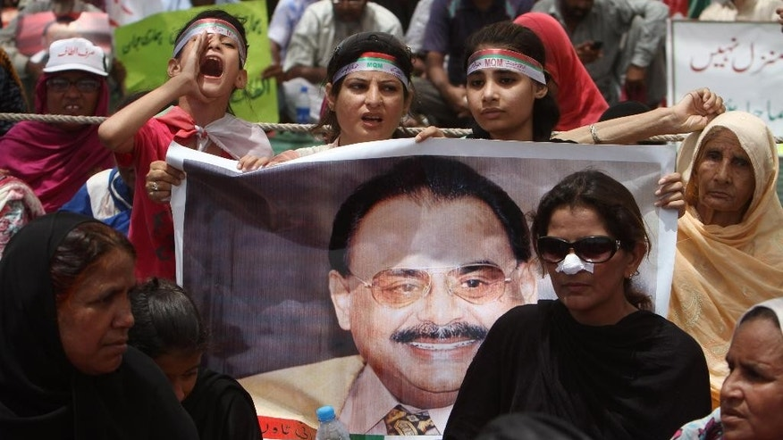 Supporters of the Muttahida Qaumi Movement, or MQM, one of Pakistan's major political parties, attend a sit-in protest condemning the arrest in London of its leader, Altaf Hussain, in Islamabad, Pakistan, Thursday, June 5, 2014. British police arrested one of Pakistan's most well-known and divisive politicians Tuesday on suspicion of money-laundering, sparking fears of violence in his power base of Karachi, where businesses closed early and residents rushed home. (AP Photo/Fareed Khan)