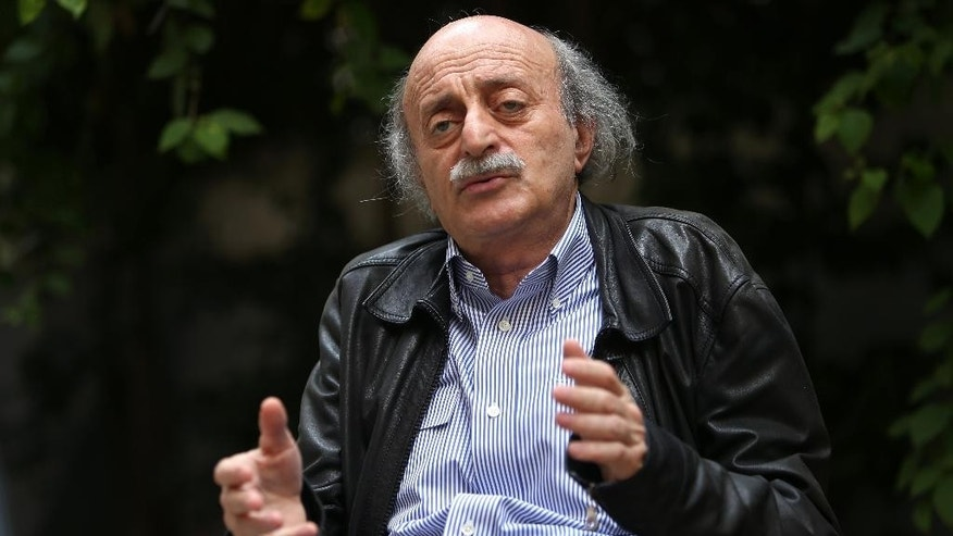 "In this picture taken on May 28, 2014, Walid Jumblatt, the political leader of Lebanon's minority Druse sect, speaks during an interview with The Associated Press as he sits in his garden house in Beirut, Lebanon. The decision by Lebanon's militant Hezbollah group to join the civil war in neighboring Syria and fight along President Bashar Assad's forces was a historical and moral ""mistake"" toward the Syrian people, a leading Lebanese politician, Jumblatt said. (AP Photo/Hussein Malla)"