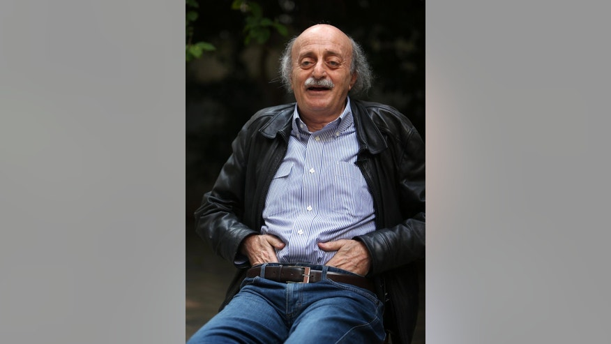 "In this picture taken on May 28, 2014, Walid Jumblatt, the political leader of Lebanon's minority Druse sect, laughs during an interview with The Associated Press as he sits in his garden house, in Beirut, Lebanon. The decision by Lebanon's militant Hezbollah group to join the civil war in neighboring Syria and fight along President Bashar Assad's forces was a historical and moral ""mistake"" toward the Syrian people, a leading Lebanese politician, Jumblatt said. (AP Photo/Hussein Malla)"
