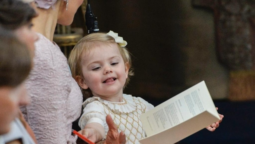 Princess Estelle stands next to her mother Crown Princess Victoria during the christening ceremony in the Drottningholm Palace church outside Stockholm, Sweden, Sunday, June 8, 2014. (AP Photo/TT, Jonas Ekstromer)   SWEDEN OUT