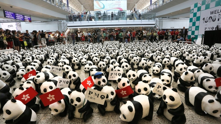 June 9, 2014 - 1,600 paper pandas, created by French artist Paulo Grangeon, displayed at the arrival hall of the Hong Kong International Airport.