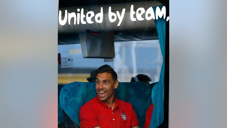 United States' Geoff Cameron reacts as the team bus arrives at the team hotel in Sao Paulo, Brazil, Monday, June 9, 2014. The U.S. will play in group G of Brazil's 2014 soccer World Cup. (AP Photo/Julio Cortez)