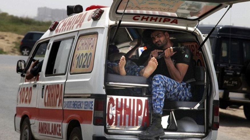 June 10, 2014: An ambulance rushes to a hospital after gunmen attacked a training center for airport security personnel in Karachi, Pakistan. (AP Photo/Shakil Adil)