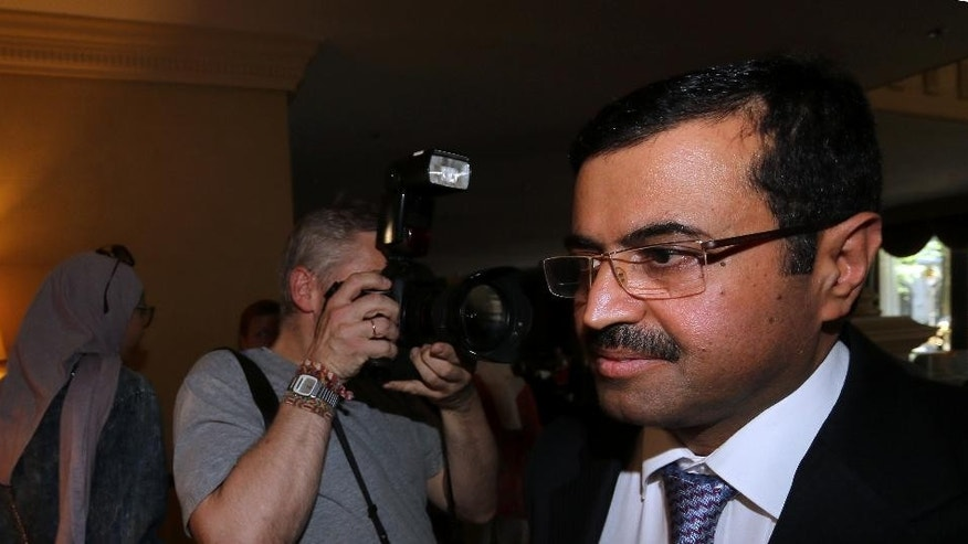 Mohammed Bin Saleh Al-Sada Minister of Energy and Industry of Qatar arrives at a hotel for a meeting of the Organization of the Petroleum Exporting countries, OPEC, in Vienna, Austria, Tuesday, June 10, 2014. (AP Photo/Ronald Zak)
