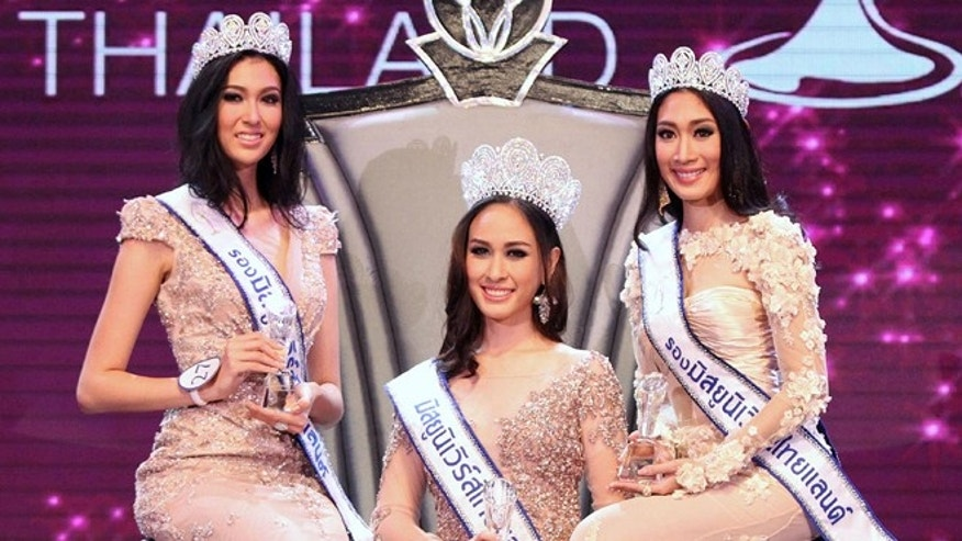 May 17, 2014: Weluree Ditsayabut, center, poses with two runner-ups Pimbongkod Chankaew, left, and Sunnanipa Krissanasuwan, right, after the Miss Universe Thailand  beauty pageant competition in Bangkok, Thailand. Weluree has resigned less than a month into her reign after being harshly criticized on social media over her political comments and looks. (AP)