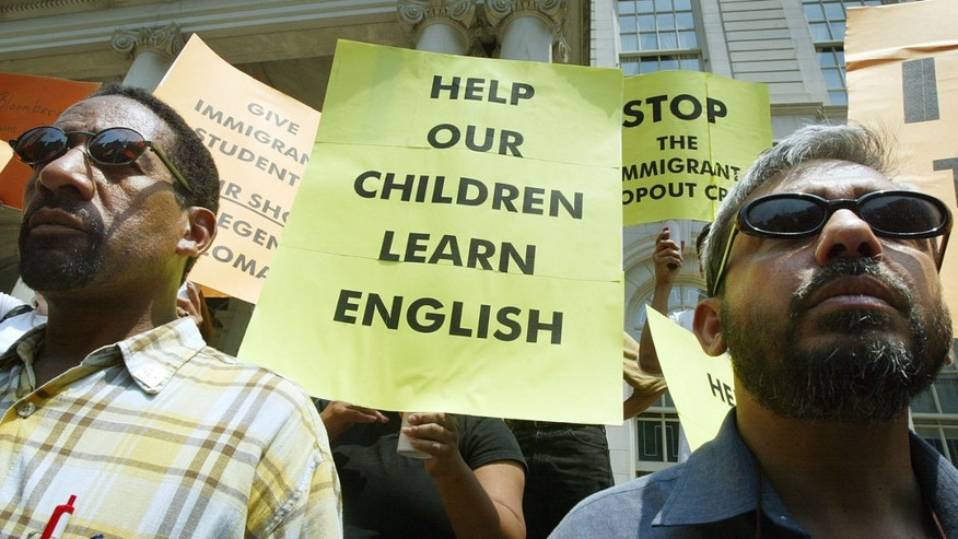NEW YORK - JUNE 16:  Parents and immigrant supporters protest the lack of quality English language instruction for immigrant students on the steps of City Hall June 16, 2004 in New York City. New York's English Regents Exam will be administered June 17th and protesters say the students are ill-prepared to pass the test.  (Photo by Mario Tama/Getty Images)