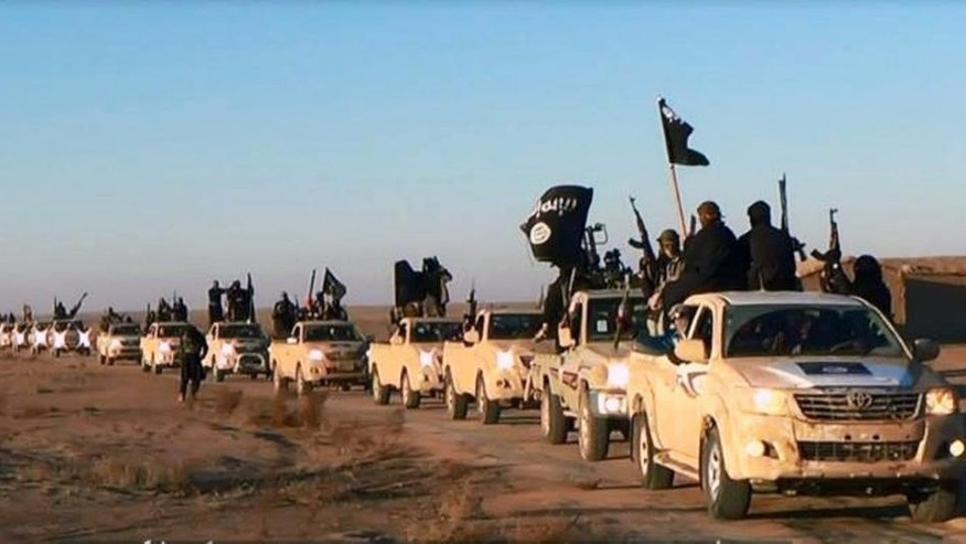 FILE - This file image posted on a militant website on Tuesday, Jan. 7, 2014, which is consistent with AP reporting, shows a convoy of vehicles and fighters from the al-Qaida-linked Islamic State of Iraq and the Levant (ISIL) fighters in Iraq's Anbar Province. The Islamic State was originally al-Qaida's branch in Iraq, but it used Syria's civil war to vault into something more powerful. It defied orders from al-Qaida's central command and expanded its operations into Syria, ostensibly to fight to topple Assad. But it has turned mainly to conquering territory for itself, often battling other rebels who stand in the way. (AP Photo/militant website, File)