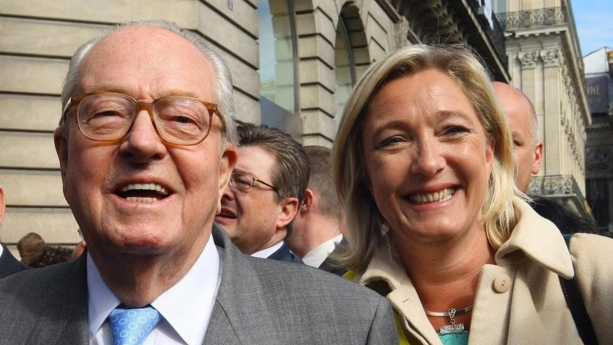 FILE - This French Saturday May 1, 2010, file photo shows far-right leader Jean-Marie Le Pen, left, and his daughter Marine Le Pen, attending a wreath-laying ceremony at the statue of Joan of Arc in Paris, France. A Greek tragedy is playing out in the House of Le Pen, the seat of France's rising far right, with the wounded patriarch lashing out at his daughter, his political heir, in a feud over an anti-Semitic smear that goes to the heart of her efforts to broaden the party's support . (AP Photo/Jacques Brinon, file)