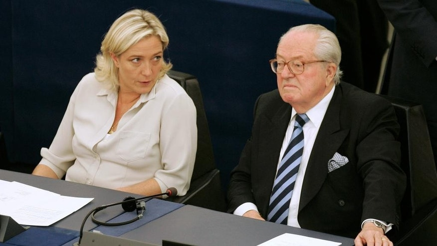 FILE - In this July 14, 2009 file photo Jean-Marie Le Pen, right, and his daughter Marine Le Pen sit at the European Parliament, in Strasbourg, eastern France. A Greek tragedy is playing out in the House of Le Pen, the seat of France's rising far right, with the wounded patriarch lashing out at his daughter, his political heir, in a feud over an anti-Semitic smear that goes to the heart of her efforts to broaden the party's support. (AP Photo/Lionel Cironneau, File)