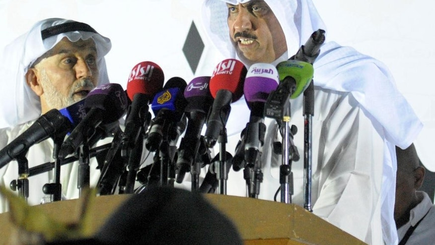 Former opposition lawmaker Musallam al-Barrack, right, gives a speech at al-Irada Square, Kuwait City on Tuesday, June 10, 2014.  Kuwaitis protested against government corruption, demanding transparency in government and an economic revival in the Gulf Arab country that was once one of the region's most attractive for foreign investment. (AP Photo/Gustavo Ferrari)