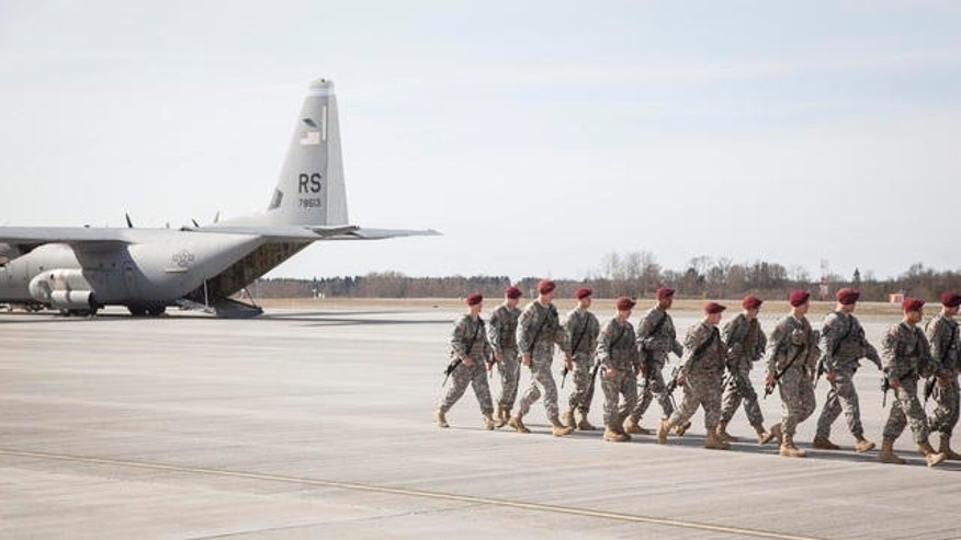 In this handout photo made available on April 28, 2014, provided by Estonia's military, a company of U.S. Army paratroopers arrive at Estonia's Amari air base as a part of America's effort to reassure its NATO allies in the Baltic region of its commitment to defense against Russia's aggression in Crimea and Ukraine. The paratroopers are based in the town of Paldiski, a former Soviet naval base, until the end of 2014, and will regularly drill and exercise with Estonian forces. (AP Photo/Estonian Defense Forces)