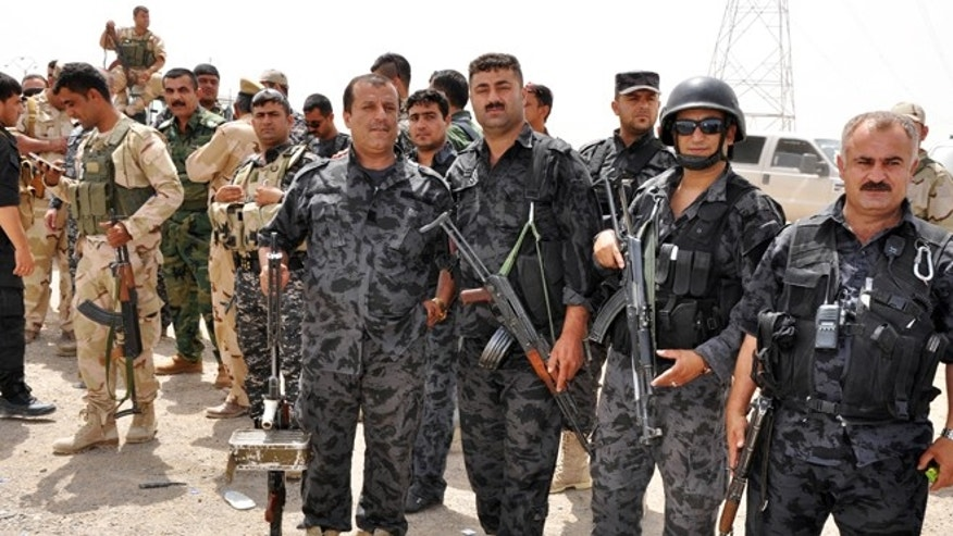 June 12, 2014: Kurdish security forces deploy outside of the oil-rich city of Kirkuk, 180 miles north of Baghdad, Iraq.