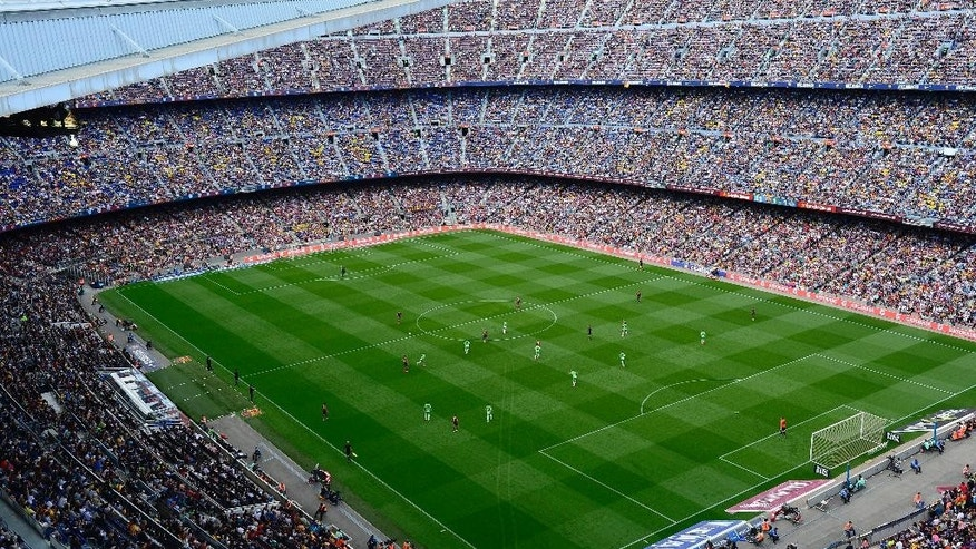In this photo taken on Saturday May 3, 2014, Barcelona F.C. plays again Getafe during a Spanish La Liga soccer match at the Camp Nou stadium in Barcelona, Spain . The European Union is investigating whether government loan guarantees for seven soccer clubs violate EU competition law, designed in part to prevent businesses from enjoying unfair advantage through state intervention. The probe is examining tax breaks granted to the Real Madrid, Barcelona, Athletic Bilbao and Osasuna soccer clubs _ but that's a small part of government assistance to Spain's soccer league, according to the AP review. (AP Photo/Manu Fernandez)
