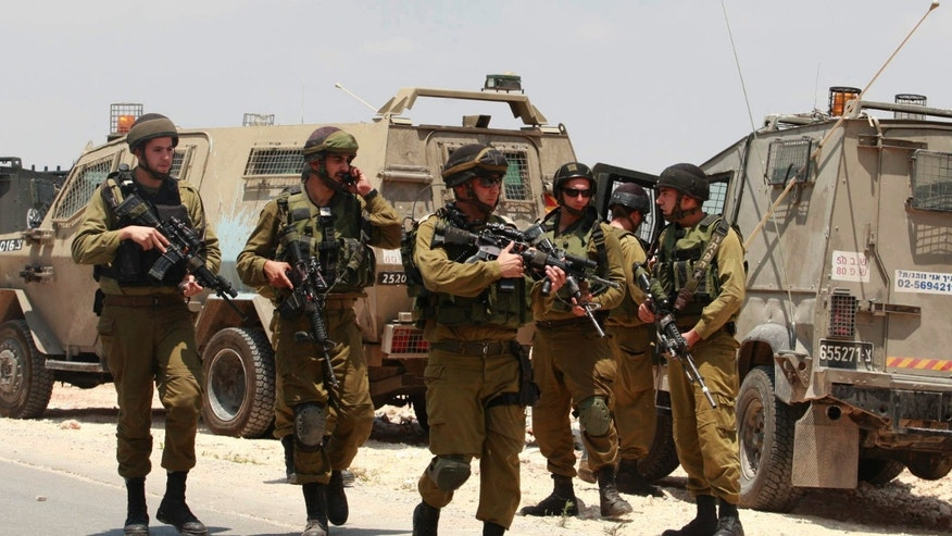June 13, 2014 - Israeli soldiers deploy near the West Bank city of Hebron. Israeli soldiers searched the West Bank on Friday for 3 missing teens from nearby settlements, one of them a U.S. citizen, amid fears Palestinian militants abducted them, authorities said.