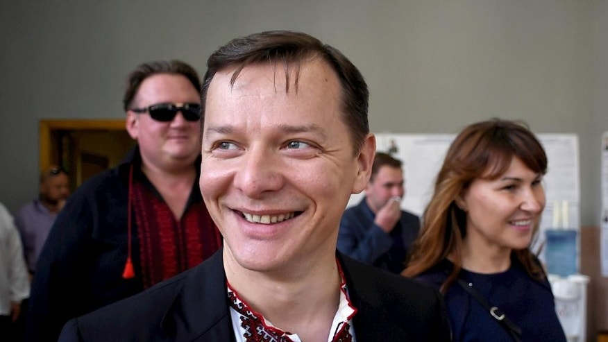 FILE In this Sunday, May, 25, 2014 file photo Ukraine's presidential candidate Oleh Lyashko smiles while voting at a polling station during the presidential election in Kiev, Ukraine. Once, he was little more than an entertaining curiosity in Ukraine?s politics, noted for bringing vegetables and livestock to parliament where he was the only representative of a fringe nationalist party. But after Oleh Lyashko took up arms in Ukraine's east and interrorgated near-naked detained separatists, his star rose.(AP Photo/Osman Karimov, file)