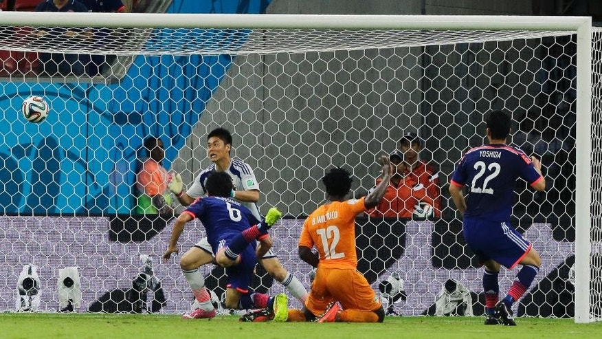Ivory Coast's Wilfried Bony, (12), scores his side's first goal during the group C World Cup soccer match between Ivory Coast and Japan at the Arena Pernambuco in Recife, Brazil, Saturday, June 14, 2014.   (AP Photo/Shuji Kajiyama)