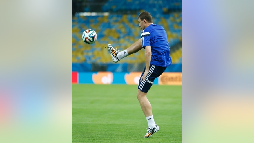 Bosnia's Edin Dzeko kicks the ball during a training session at the Maracana Stadium in Rio de Janeiro, Brazil, Saturday, June, 14, 2014. Bosnia-Herzegovina will face Argentina in group F of the 2014 soccer World Cup at the stadium on Sunday. (AP Photo/Victor R. Caivano)