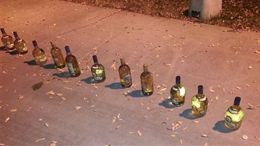 In this November 2012 photo provided by PARC Environmental, a traffic stop on Interstate 5 led to the seizure of multiple tequila bottles disguising liquid methamphetamine near Coalinga, Calif. Authorities in Californiaâs Central Valley say that in recent years they have begun to see more meth dissolved as liquid and put into tequila bottles or plastic detergent containers to smuggle it across the border from Mexico. Once in the Central Valley, it is converted into crystals, itâs most sought-after form on the street. (AP Photo/PARC Environmental)