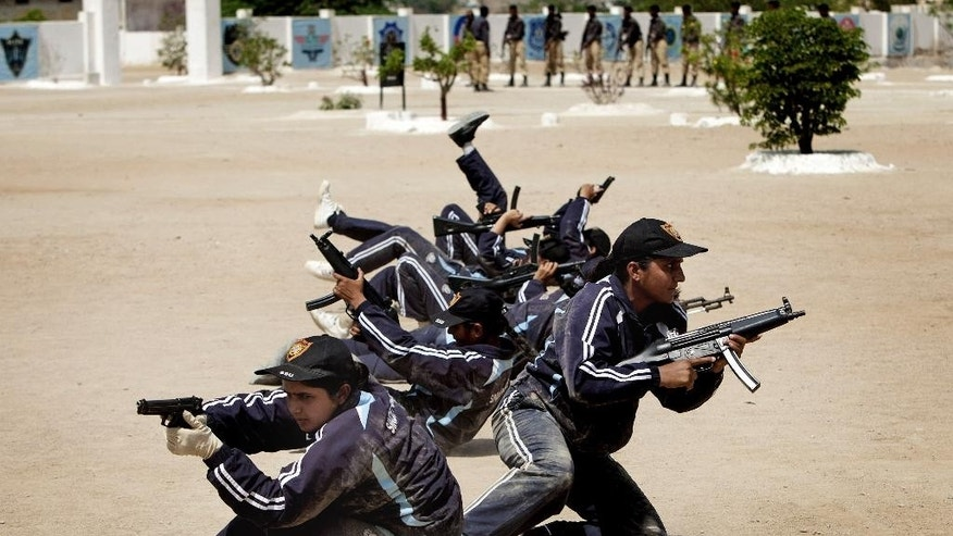 In this Wednesday, May 7, 2014 photo, Pakistani police commandos participate in a training session in Karachi, Pakistan. In a country where women have traditionally not worked outside the home and face widespread discrimination, the appointments represent a significant step for women's empowerment. (AP Photo/Shakil Adil)