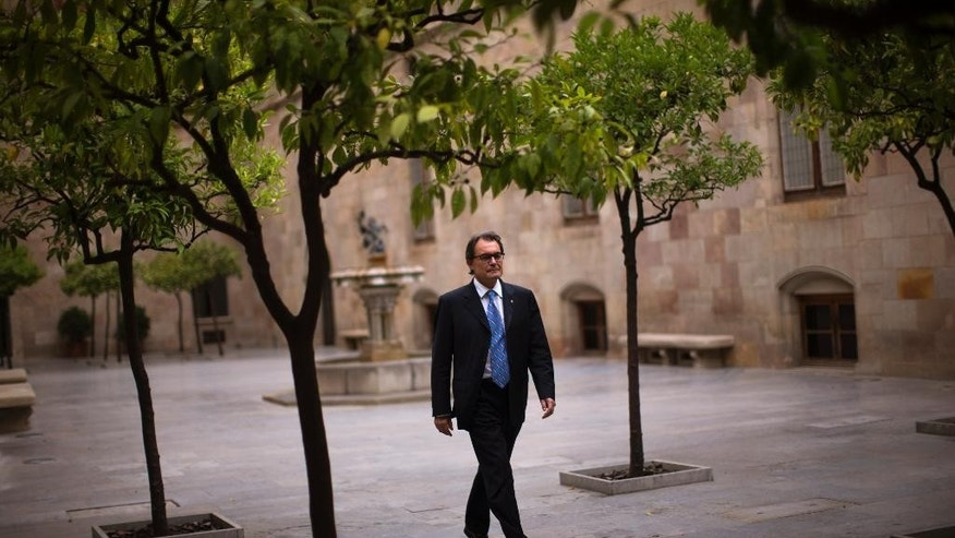 In this photo taken on Friday, June 13, 2014 Catalonia's regional president Artur Mas walks inside the Generalitat Palace, the main head office of the Government of Catalonia, ahead of an interview in Barcelona, Spain. If Catalonia's regional president wins backing for his goal in a planned Nov. 9 local referendum on whether to secede, his success will not only fuel the independence cause in the nearby Basque country. It will also encourage other separatist-minded regions across the continent, such as Belgium's Dutch speakers, even if Scotland votes against its own proposal for independence in September. (AP Photo/Emilio Morenatti)