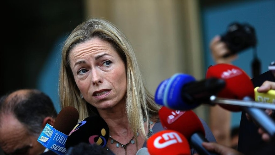 Kate McCann, the mother of the missing British girl Madeleine McCann, talks to journalists as she leaves with her husband a court in Lisbon Monday, June 16, 2014. The couple arrived to Lisbon for their libel action against former Portuguese detective Goncalo Amaral who published a book about Madeleine's disappearance. (AP Photo/Francisco Seco)