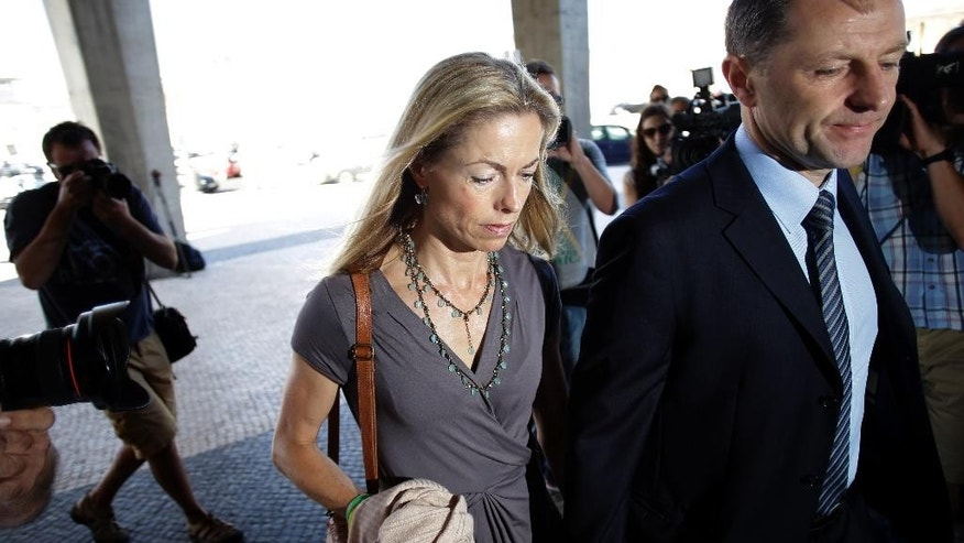 Kate, centre, and Gerry McCann, the parents of the missing British girl Madeleine McCann, arrive at a court, in Lisbon, Monday, June 16, 2014, for their libel action against former Portuguese detective Goncalo Amaral who published a book about Madeleine's disappearance. Madeleine was three years old when she vanished from her holiday apartment in Praia da Luz, southern Portugal, while her parents were having dinner nearby on May 3, 2007. (AP Photo/Francisco Seco)