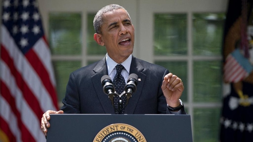 """FILE - This May 27, 2014, file photo shows President Barack Obama, standing in the White House Rose Garden, and speaking about the future of US troops in Afghanistan. Obama outlined a timetable for the gradual withdrawal of the last U.S. troops in Afghanistan, and confidently declared, """"This is how wars end in the 21st century."""" But less than three weeks later, there is a sudden burst of uncertainty surrounding the way Obama has moved to bring the two conflicts he inherited to a close. In Iraq, a fast-moving Islamic insurgency is pressing toward Baghdad, raising the possibility of fresh American military action more than two years after the last U.S. troops withdrew.  (AP Photo/Carolyn Kaster)"""