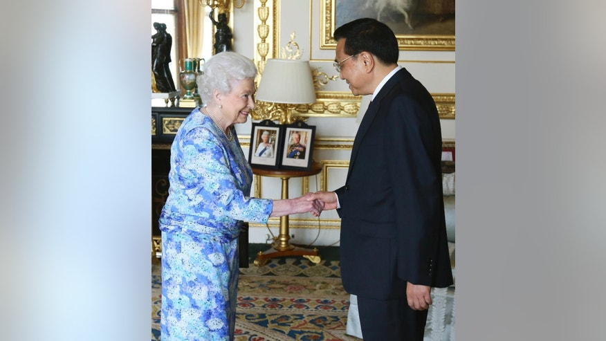 Britain's Queen Elizabeth II, left, receives Chinese premier Li Keqiang at Windsor Castle, during their visit to the Britain, Tuesday, June 17, 2014. (AP Photo/Steve Parsons, pool)