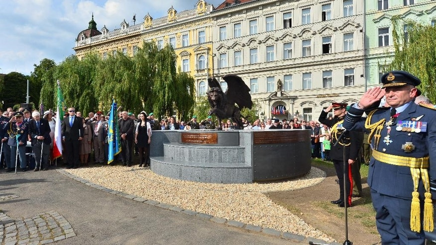 The monument in memory of Czechoslovak WWII pilots in the British Royal Air Force (RAF), which is opposed by heritage protectors, was unveiled in a park in Prague centre, Tuesday, June 17, 2014. The two-metre bronze statue of a winged lion, made by British sculptor Colin Spofforth, stands on a concrete plinth. It was donated by the British community living in the Czech Republic. (AP Photo/CTK, Vit Simanek) SLOVAKIA OUT