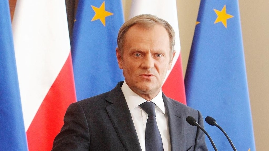 Poland's Prime Minister Donald Tusk gestures as he tells a news conference in Warsaw, Poland on Monday, June 16, 2014, that he sees no reason to fire the Interior Minister after a secret recording was published in the media, suggesting he was making an improper under-the-table deal with the head of the central bank. Tusk said the two official did not break the law, but were discussing ways of helping the Polish state. (AP Photo/Czarek Sokolowski)