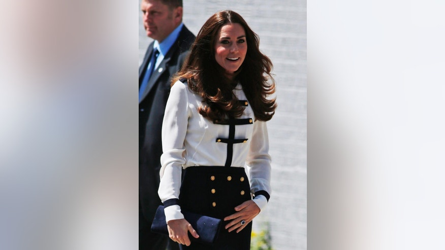 Britain's Kate, Duchess of Cambridge arrives for a visit at Bletchley Park, near Milton Keynes, England, Wednesday, June 18, 2014. The Duchess will view the restored location, tour the WWII Codebreaking Huts and will hear about the achievements of the Codebreakers whose work is said to have helped shorten the World War II by two years. (AP Photo/Lefteris Pitarakis)