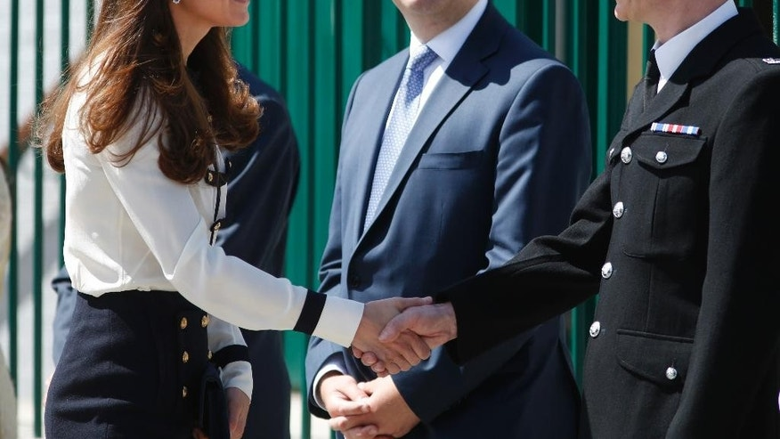 Britain's Kate, Duchess of Cambridge meets officials as she arrives for a visit at Bletchley Park, near Milton Keynes, England, Wednesday, June 18, 2014. The Duchess will view the restored location, tour the WWII Codebreaking Huts and will hear about the achievements of the Codebreakers whose work is said to have helped shorten the World War II by two years. (AP Photo/Lefteris Pitarakis)