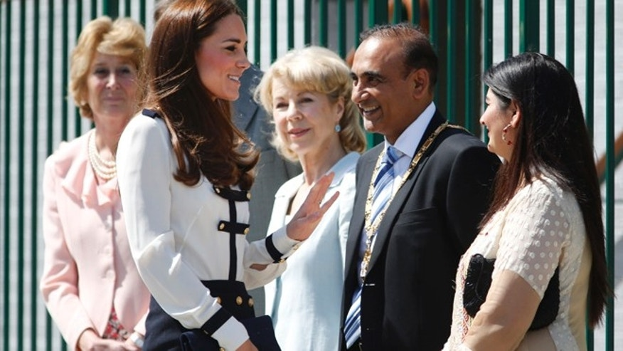 June 18, 2014: Britain's Kate, Duchess of Cambridge, foreground left, meets officials as she arrives for a visit at Bletchley Park, near Milton Keynes, England. (AP)