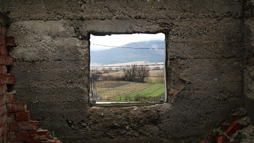This Feb. 5, 2014 photo shows a view out of the window of the house that Gavrilo Princip was born in the village of Obljaj, near Bosansko Grahovo, 300 kilometers west of Sarajevo, Bosnia. A century later, Gavrilo Princip still provokes controversy from beyond the grave as his legacy has been molded time and again to meet political agendas in the Balkans, still a patchwork of ethnic and religious rivalries. (AP Photo/Amel Emric)