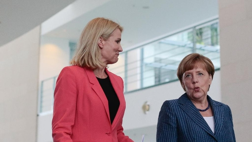 German Chancellor Angela Merkel, right, and the Prime Minister of Denmark Helle Thorning-Schmidt arrive for a news conference after a meeting at the chancellery in Berlin, Thursday, June 19, 2014. (AP Photo/Markus Schreiber)