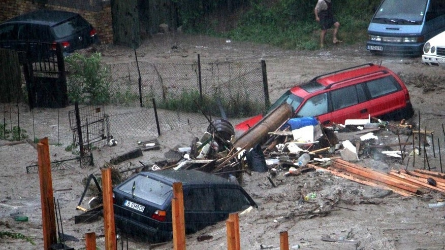 Cars pile up in the flooded area of the Black sea town of Varna, Bulgaria, Thursday, June 19, 2014. Two people and a child are reported dead and four more are missing. Torrential rain caused severe flooding in Bulgaria, sweeping away cars, reducing scores of homes to rubble, the country's civil defense authority said.  (AP Photo/ImpactPressGroup)