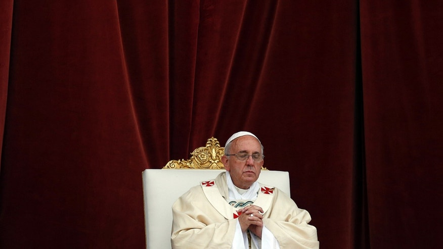 Pope Francis celebrates a mass outside  St. John at the Lateran Basilica to mark the feast of the Body and Blood of Christ, in Rome, Thursday,  June 19, 2014. The event is dedicated to the mystery of the Eucharist and concludes the cycle of feasts following Easter. (AP Photo/Gregorio Borgia)