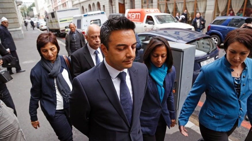 Preyen Dewani, center,  brother of murder accused Shrien Dewani arrives at the High Court before his brothers brief appearance in Cape Town, South Africa, Friday, June 20, 2014. Dewani is accused of arranging the killing of his wife, Anni, on their honeymoon in South Africa, November 2010, his court case was postponed. (AP Photo/Schalk van Zuydam)