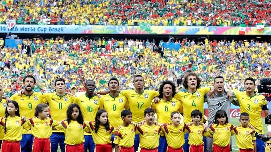 The Brazil team sing their national anthem before the group A World Cup soccer match between Brazil and Mexico at the Arena Castelao in Fortaleza, Brazil, Tuesday, June 17, 2014.   (AP Photo/Andre Penner)