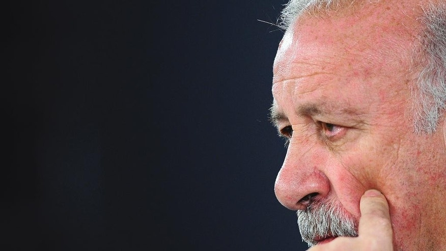 Spain's head coach Vicente del Bosque gestures during a press conference at the Atletico Paranaense training center in Curitiba, Brazil, Friday, June 20, 2014. Spain will play in group B of the Brazil 2014 World Cup. (AP Photo/Manu Fernandez)